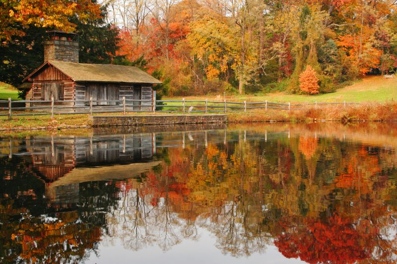 Autumn-landscape-fall-colors-reflecting-in-pond