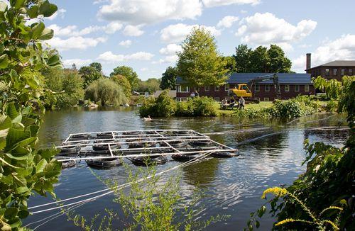 The pond source geothermal system being installed, photo by Derek Hayn