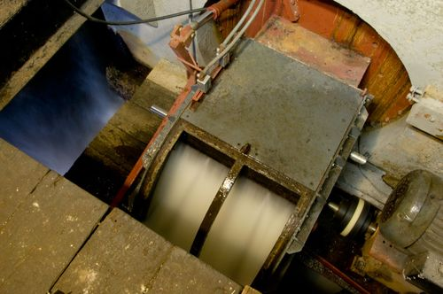 Hydropower turbine doing its thing, photo by Derek Hayn